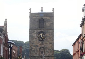 Old stone tower with two half life-size statues, Morpeth, Northumberland