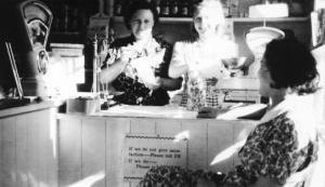 Nellie and Betty Manterfield serving in the shop (1954)